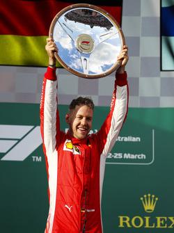 Sebastian Vettel, Ferrari, celebrates victory on the podium