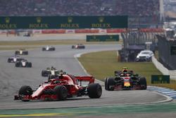 Kimi Raikkonen, Ferrari SF71H, leads Max Verstappen, Red Bull Racing RB14