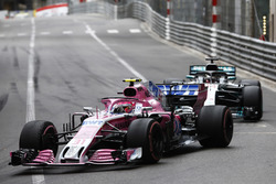 Esteban Ocon, Force India VJM11, leads Lewis Hamilton, Mercedes AMG F1 W09