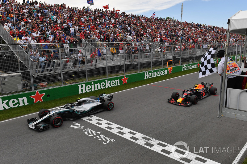 Valtteri Bottas, Mercedes-AMG F1 W09 and Max Verstappen, Red Bull Racing RB14 take the chequered flag