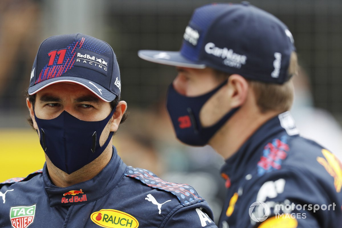 Sergio Perez, Red Bull Racing, and Max Verstappen, Red Bull Racing, on the grid, ahead of the 2022 Formula 1 car unveiling