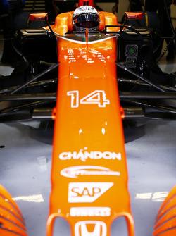 Fernando Alonso, McLaren, in cockpit, in garage, with helmet visor raised