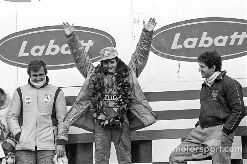 Podium: race winner Gilles Villeneuve, Ferrari, second place Jody Scheckter, Wolf, third place Carlo