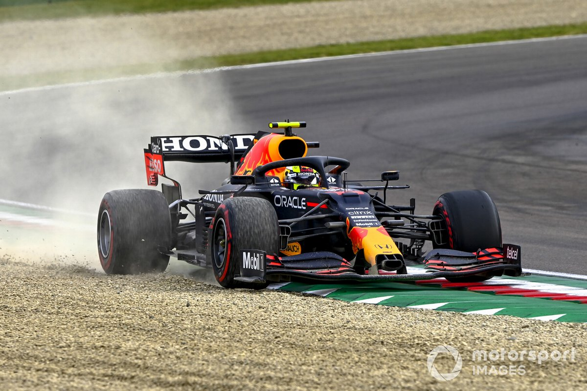 Sergio Perez, Red Bull Racing RB16B, runs wide