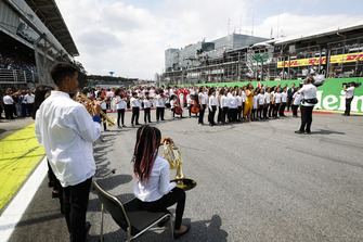 The national anthem is performed on the grid prior to the start