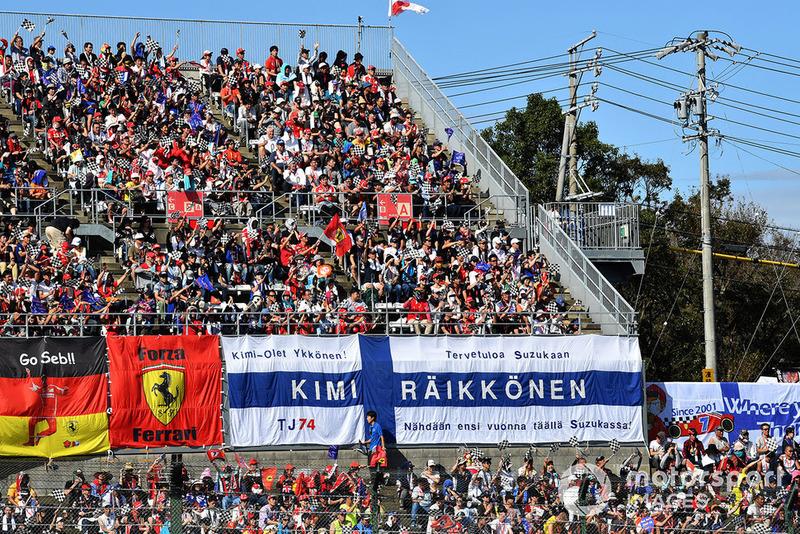 Sebastian Vettel, Ferrari and Kimi Raikkonen, Ferrari fans and banners