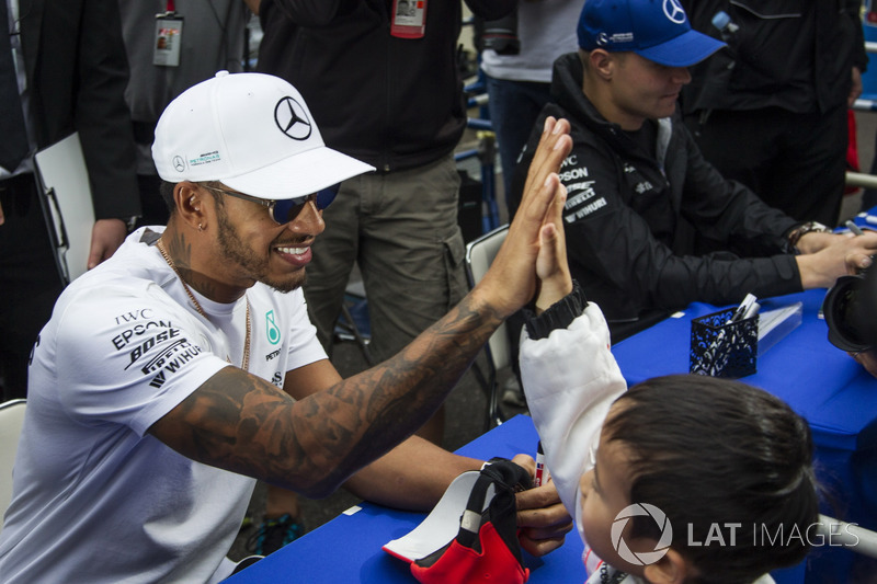 Lewis Hamilton, Mercedes AMG F1 high fives a young fan