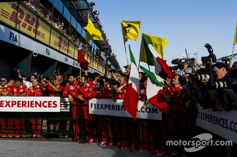 The Ferrari team in Parc Ferme