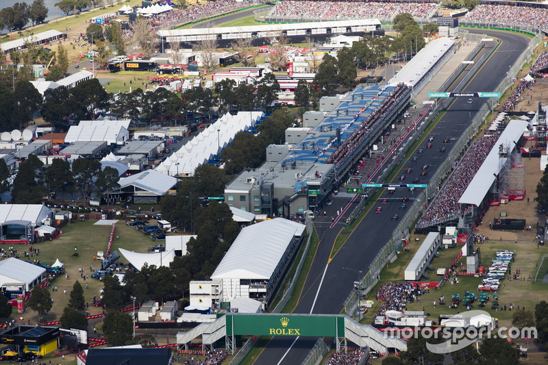 Lewis Hamilton, Mercedes AMG F1 W08, and Sebastian Vettel, Ferrari SF70H, lead the field away at the start