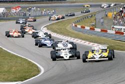 René Arnoux, Renault RE30 leads Alan Jones, Williams FW07C-Ford Cosworth, Nelson Piquet Brabham, BT4