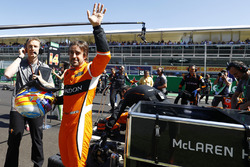 Fernando Alonso, McLaren, waves to fans