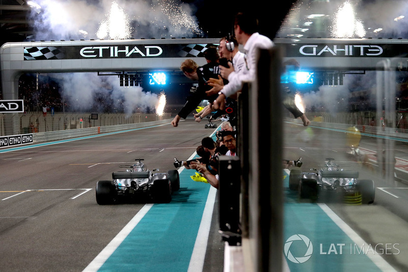 Valtteri Bottas, Mercedes-Benz F1 W08 crosses the line to take the chequered flag and win the race and celebrates with the team on pitwall