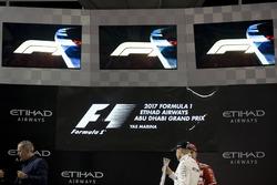 Podium: Race winner Valtteri Bottas, Mercedes AMG F1 with the new F1 logos above
