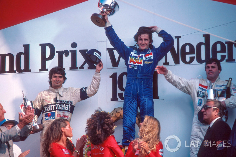 Podium: race winner Alain Prost, Renault, second place Nelson Piquet, Brabham, third place Alan Jones, Williams