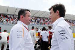 Eric Boullier, Racing Director, McLaren, and Toto Wolff, Executive Director (Business), Mercedes AMG, on the grid