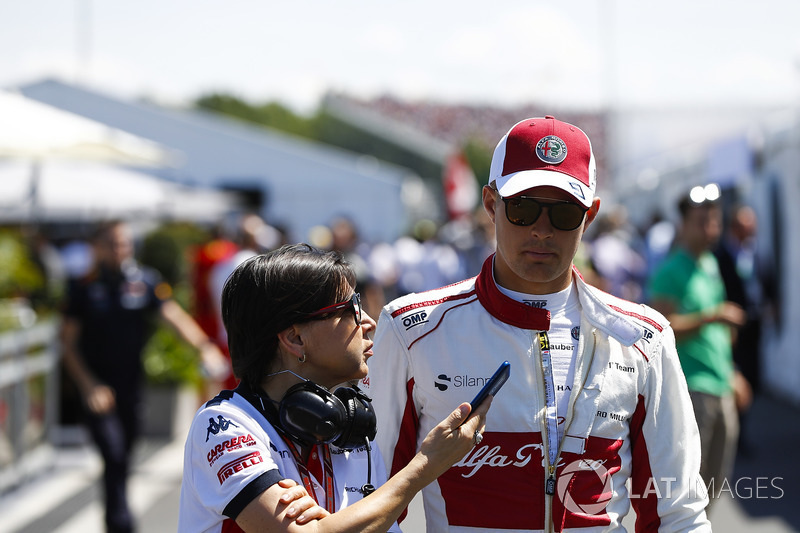 Marcus Ericsson, Sauber, talks to a press officer in qualifying