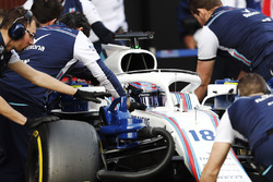 Lance Stroll, Williams Racing, is pushed into his pit by mechanics