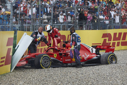 Sebastian Vettel, Ferrari SF71H, climbs out of his car after crashing out from the lead