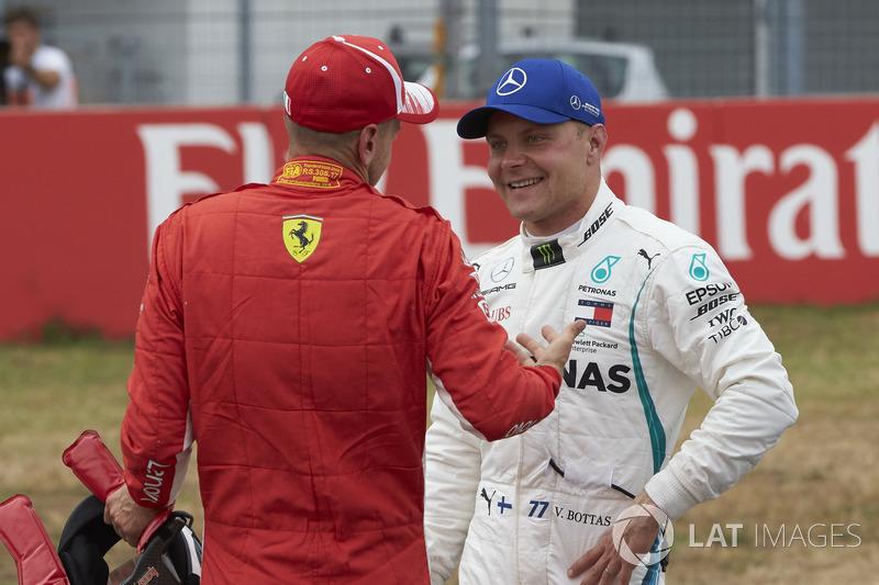Pole sitter Sebastian Vettel, Ferrari, and Valtteri Bottas, Mercedes AMG F1