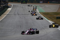 Esteban Ocon, Force India VJM11, leads Carlos Sainz Jr., Renault Sport F1 Team R.S. 18, and Kevin Magnussen, Haas F1 Team VF-18