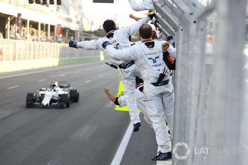 Lance Stroll, Williams FW40, is greeted by his mechanics at the finish