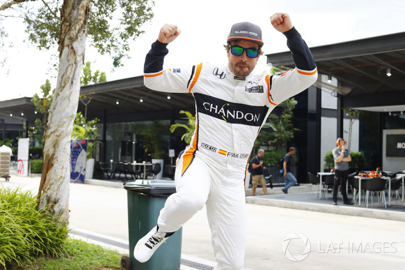 Fernando Alonso, McLaren, jumps through the frame