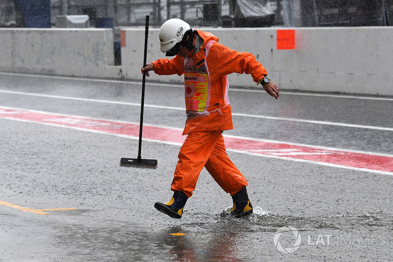 Marshals and flooded pit lane