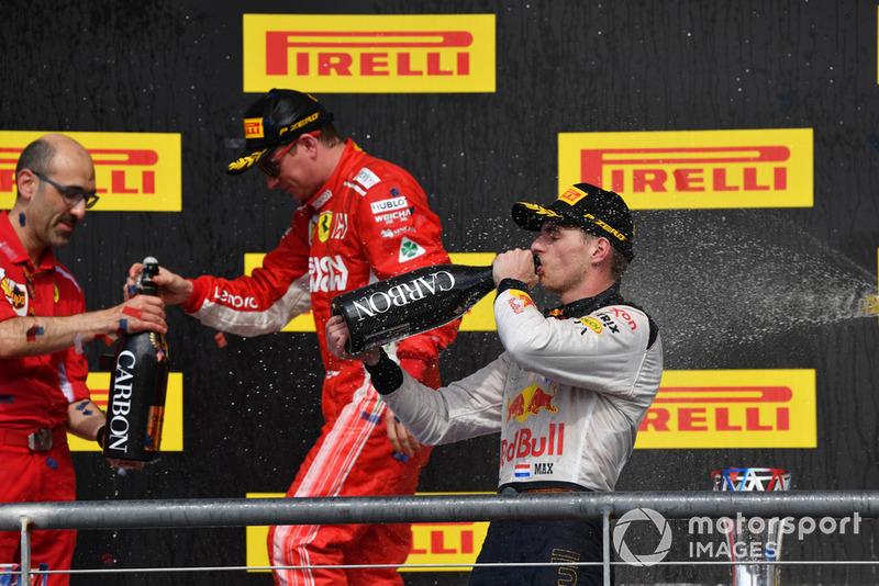 (L to R): Carlo Santi, Ferrari Race Engineer, Kimi Raikkonen, Ferrari and Max Verstappen, Red Bull Racing celebrate with the champagne