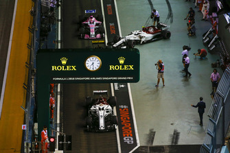 Marcus Ericsson, Sauber C37, Nico Hulkenberg, Renault Sport F1 Team R.S. 18, Charles Leclerc, Sauber C37, and Esteban Ocon, Racing Point Force India VJM11, in the pit lane.