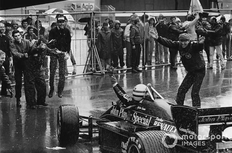 Ayrton Senna, Lotus 97T-Renault celebrates 1st position with Team Manager Peter Warr in parc ferme, portrait