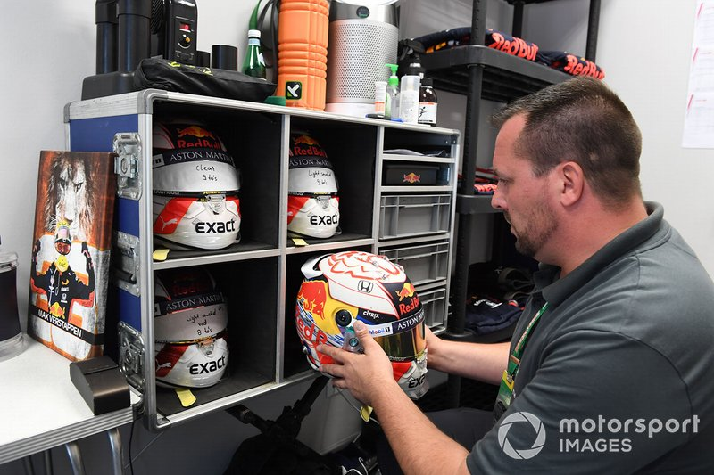 Schuberth's Sven Krieter works on the helmet of Max Verstappen