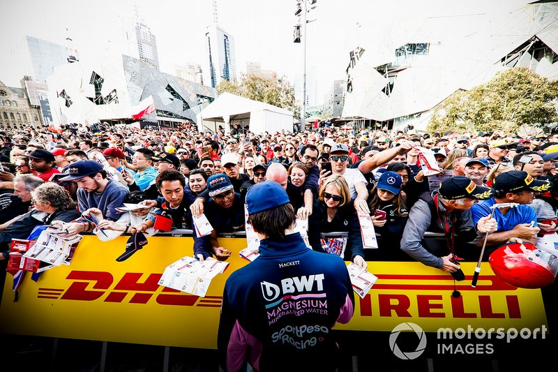 Lance Stroll, Racing Point signs autographs for fans at the Federation Square event