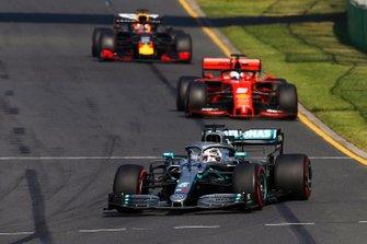 Lewis Hamilton, Mercedes AMG F1 W10, leads Sebastian Vettel, Ferrari SF90, and Max Verstappen, Red Bull Racing RB15
