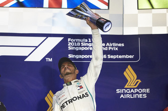 Lewis Hamilton, Mercedes AMG F1, 1st position, lifts his trophy on the podium