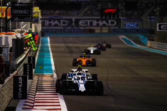 Lance Stroll, Williams FW41, leads Charles Leclerc, Sauber C37, and Stoffel Vandoorne, McLaren MCL33