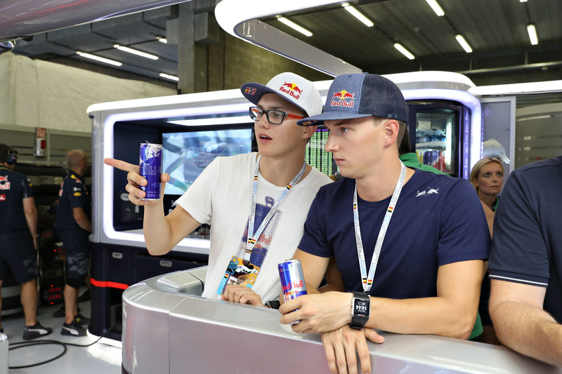 Rallycross drivers, Timmy and Kevin Hansen in the Red Bull Racing garage during qualifying