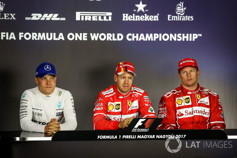 Прес-конференція: володар поул-позиції Себастьян Феттель, Ferrari, друге місце Кімі Райкконен, Ferrari, третє місце Валттері Боттас, Mercedes AMG F1