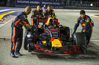 Max Verstappen, Red Bull Racing RB13 is pushed by mechanics