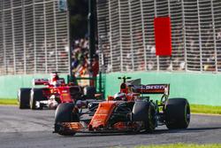Stoffel Vandoorne, McLaren MCL32, leads Sebastian Vettel, Ferrari SF70H
