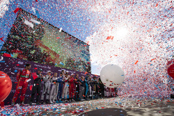 Ticker tape and baloons on the podium