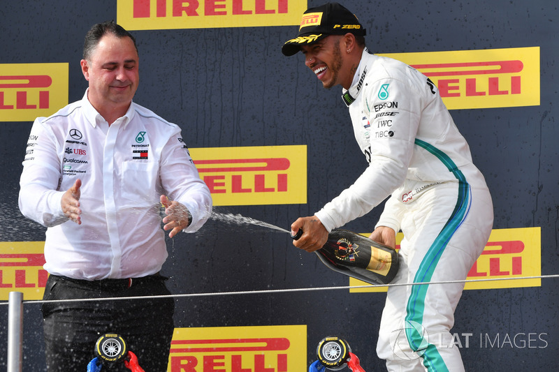 Ron Meadows, Mercedes AMG F1 Team Manager and Lewis Hamilton, Mercedes-AMG F1 celebrate on the podium with the champagne
