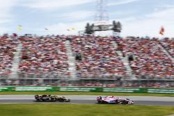 Esteban Ocon, Force India VJM11, leads Carlos Sainz Jr., Renault Sport F1 Team R.S. 18