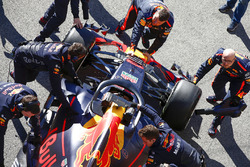 Daniel Ricciardo, Red Bull Racing RB14, being pushed back into the garage