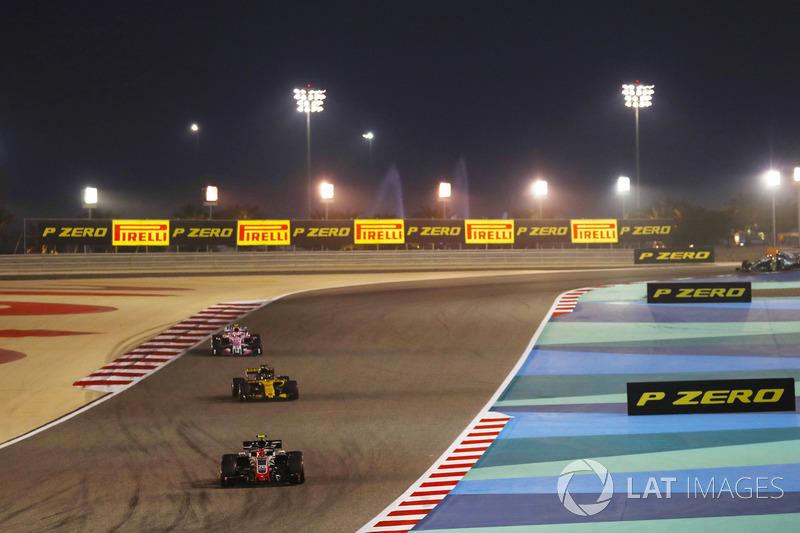 Kevin Magnussen, Haas F1 Team VF-18 Ferrari, leads Nico Hulkenberg, Renault Sport F1 Team R.S. 18, and Esteban Ocon, Force India VJM11 Mercedes