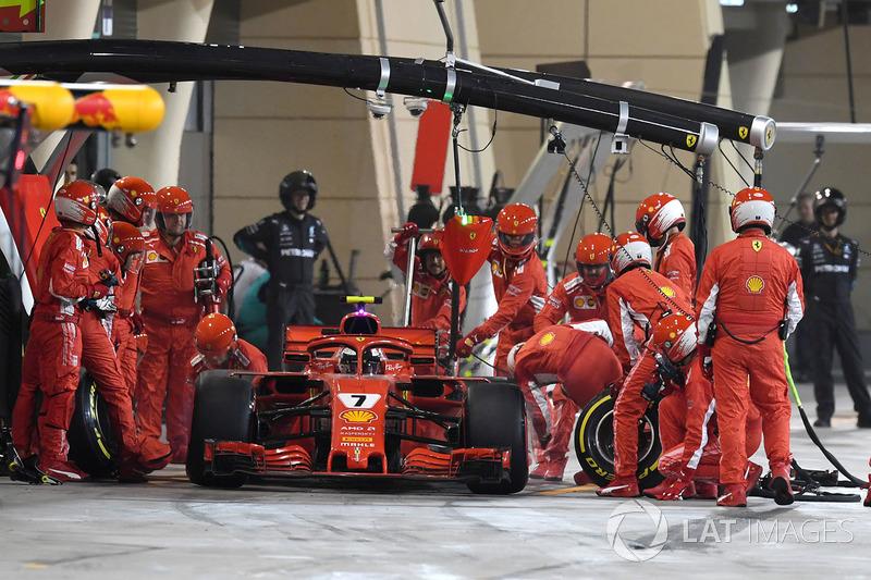Kimi Raikkonen, Ferrari SF71H hits a mechanic as he leaves the pits