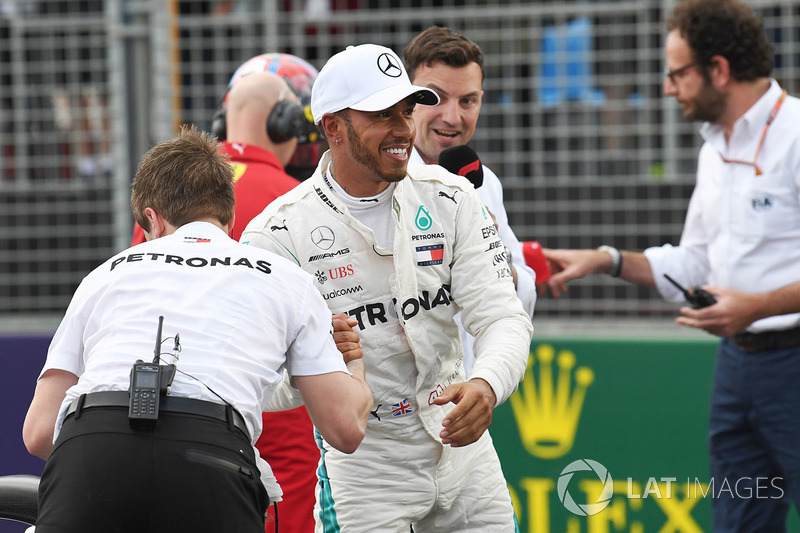 Pole sitter Lewis Hamilton, Mercedes-AMG F1 celebrates in parc ferme as Will Buxton, looks on
