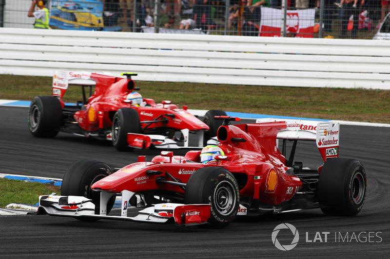 Felipe Massa, Ferrari F10 leads Fernando Alonso, Ferrari F10