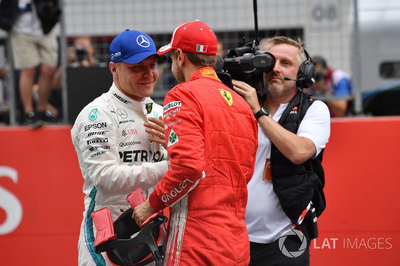 Valtteri Bottas, Mercedes-AMG F1 y Sebastian Vettel, Ferrari