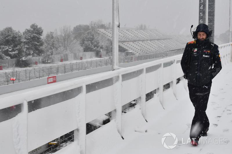 Red Bull Racing mechanic as snow stops testing