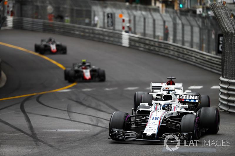 Lance Stroll, Williams FW41, leads Marcus Ericsson, Sauber C37, Kevin Magnussen, Haas F1 Team VF-18, and Romain Grosjean, Haas F1 Team VF-18